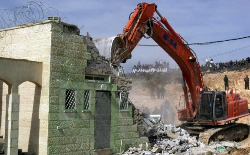 Israeli forces demolish a house during clashes in the West Bank outpost settlement of Amona, on February 1, 2006. Israel's Supreme Court has ordered that the demolition of a wildcat settlement outpost in the northern West Bank be postponed until the end of April, a court document released on Tuesday showed