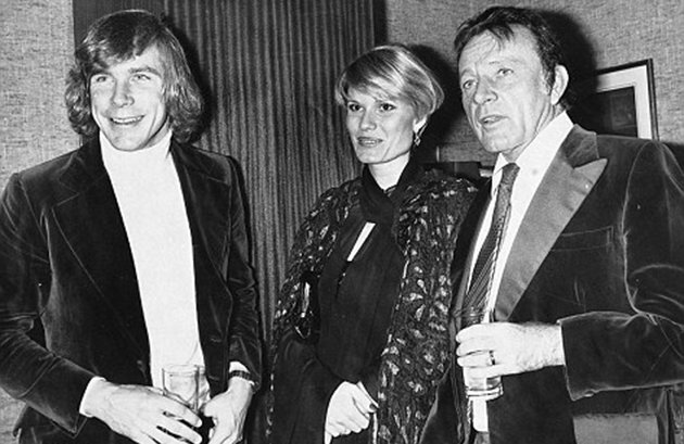 Caught between two men: James Hunt, Suzy Miller, and Richard Burton in 1976