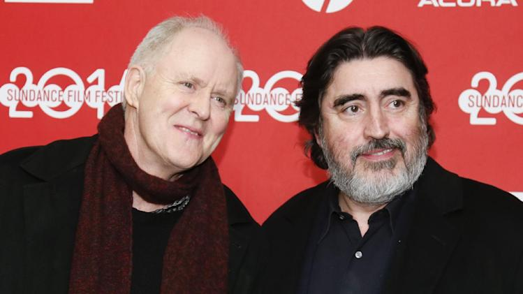 "Cast members John Lithgow, left, and Alfred Molina, right, pose at the premiere of the film ""Love is Strange"" during the 2014 Sundance Film Festival, on Saturday, Jan. 18, 2014 in Park City, Utah. (Photo by Danny Moloshok/Invision/AP)"