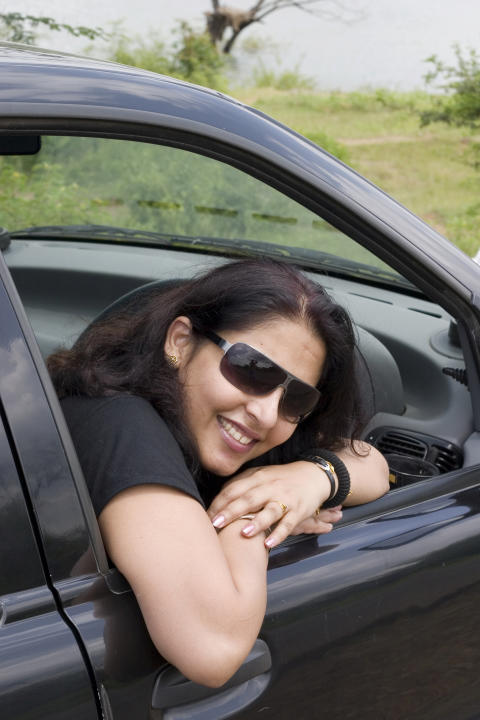 One Indian Asian Female Woman in a Car People Vertical