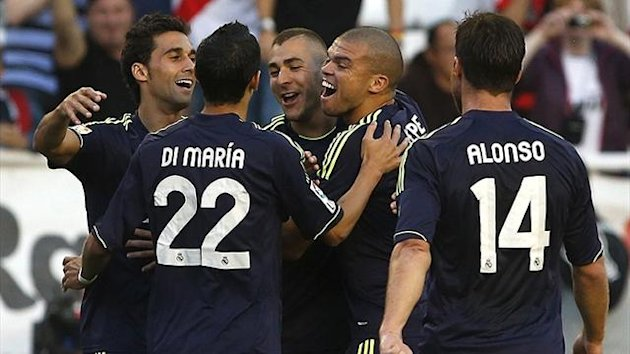 Real Madrid celebrate against Rayo Vallecano (Reuters)