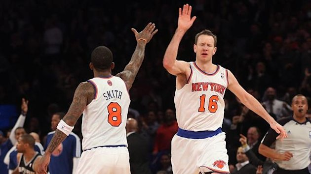 J.R. Smith of the New York Knicks salutes team-mate Steve Novak after his fourth quarter basket against the San Antonio Spurs (AFP)