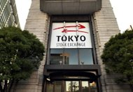 The Tokyo Stock Exchange building in Tokyo. Asian markets fell on Tuesday, as weakening demand for imports in China provided new evidence of a slowdown in the region's biggest economy and investors shrugged off a eurozone bid to help Spain