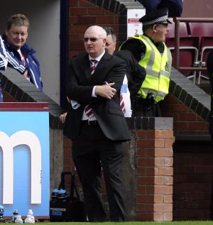 John McGlynn s not worried by the latest wage delay at Hearts