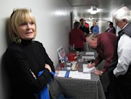 Mid-South Tea Party member Jan Allen stands in front of the sign-in desk at a meeting where two Occupy Memphis members were speaking, Thursday, Nov. 17, 2011, in Bartlett, Tenn. (AP Photo/Adrian Sainz)