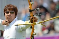 South Korea's Im Dong-Hyun competes during a men's individual archery elimination round at the London Olympics on July 30. South Korea's peerless archers, included the legally blind Im, hit the bull's-eye with three out of four gold medals