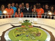 "Image provided by the London Organising Committee of the Olympic and Paralympic Games shows British director Danny Boyle (C) looking at a model of the set being built in London's Olympic Stadium for the opening ceremony. The pastoral set of meadows has stumped commentators, drawing comparisons to the children's show ""Teletubbies"""