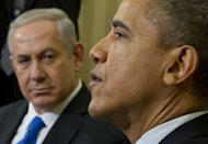 US President Barack Obama and Israeli PM Benjamin Netanyahu (L) speak at the Oval Office in Washington on March 5, 2012. Netanyahu's office is asking the public to choose an official logo for next month's state visit of Obama by voting for one of three proposed designs on Facebook