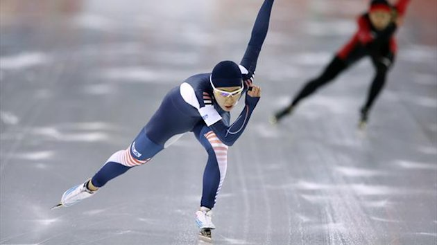 South Korea's Lee Sang-hwa leads China's Wang Beixing during the women's 500 metres speed skating race at the Adler Arena (Reuters)