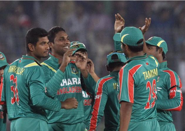 Bangladesh's fielders congratulate Sohag Gazi after he successfully dismissed New Zealand's Hamish Rutherford during their first ODI cricket match in Dhaka