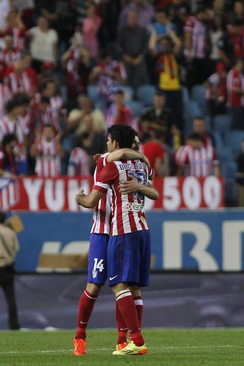 Atletico's Diego Costa celebrates with Gabi after a Spanish La Liga soccer match between Atletico de Madrid and Elche at the Vicente Calderon stadium in Madrid, Spain, Friday, April 18, 2014
