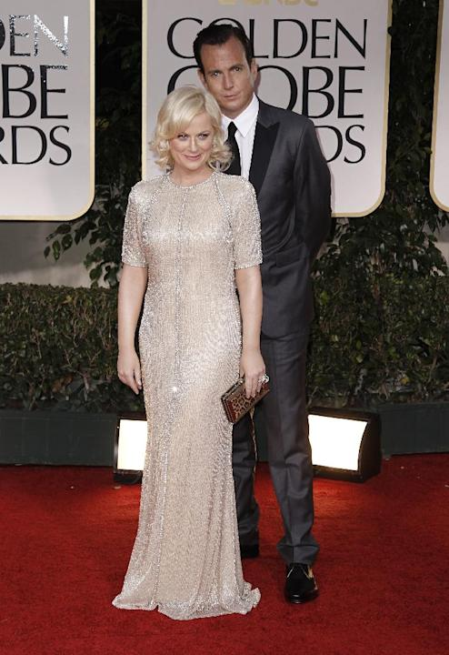 FILE - This Jan. 15, 2012 file photo shows actors Amy Poehler, left, and Will Arnett arriving at the 69th Annual Golden Globe Awards in Los Angeles. Arnett filed for divorce from Poehler on April 8, 2
