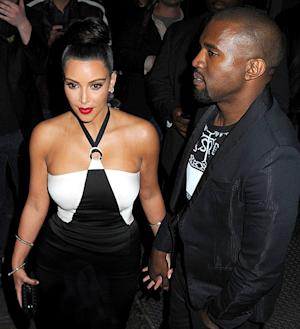 PIC: Kanye West, Kim Kardashian Hold Hands, Wear Matching Outfits