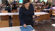 CBC reporter Lisa Johnson takes a swab sample from a food tray at a Vancouver-area shopping mall.