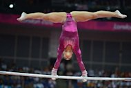 US gymnast Alexandra Raisman performs on the uneven bars during the artistic gymnastics women's individual all-around final during the London 2012 Olympic Games. Raisman said she was disappointed to have missed out on a medal by such a slender margin