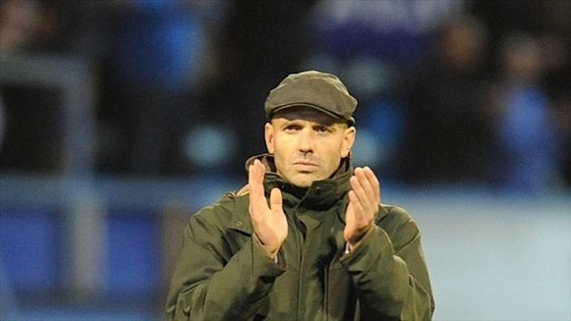 Exeter boss Paul Tisdale, pictured here applauding the City fans after their 3-2 defeat against Portsmouth last month, has met Pompey officials about the vacant post