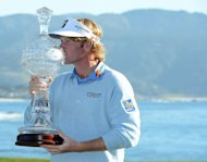 Brandt Snedeker poses with the trophy on the 18th green after his two-stroke victory at the AT&T Pebble Beach National Pro-Am at Pebble Beach Golf Links on February 10, 2013 in Pebble Beach, California