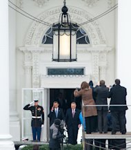"President Barack Obama salutes as he and U.S. Senator Charles Ellis ""Chuck"" Schumer (D-NY) depart the White House for Capitol Hill and the swearing-in of Obama as the nation's 44th President, Monday, Jan. 21, 2013, in Washington, DC."