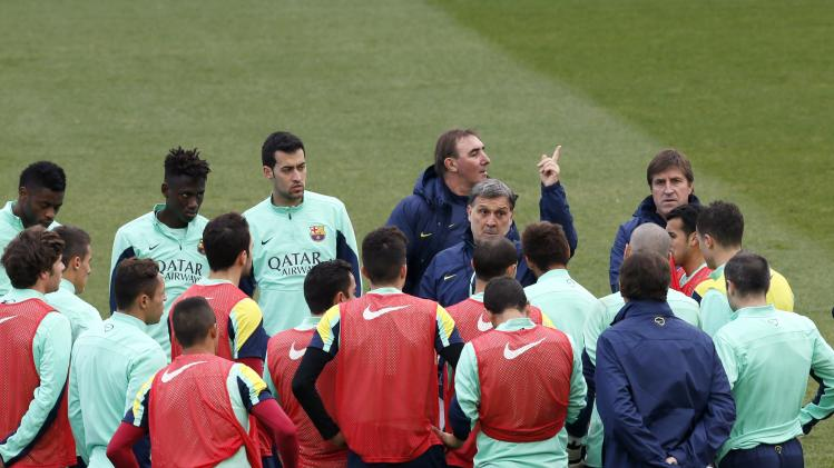 Barcelona coach Martino gestures to his players during an open training session at Mini stadium in Barcelona