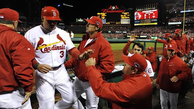 St. Louis Cardinals right fielder Carlos Beltran (3) is welcomed back to the dugout after scoring a run in the third inning during game six of the National League Championship Series baseball game against the Los Angeles Dodgers at Busch Stadium (Reuters)