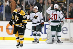 Oct 28, 2014; Boston, MA, USA; Boston Bruins left wing Brad Marchand (63) reacts to being defeated by the Minnesota Wild 4-3 at TD Banknorth Garden. (Greg M. Cooper-USA TODAY Sports)