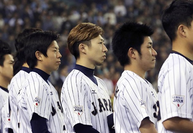 Japan's pitcher Chihiro Kaneko, center, stands in line before Game 4 between All-Stars of Japan and the Major League at their exhibition baseball series at Tokyo Dome in Tokyo, Sunday, Nov. 16, 2014. (AP Photo/Koji Sasahara)
