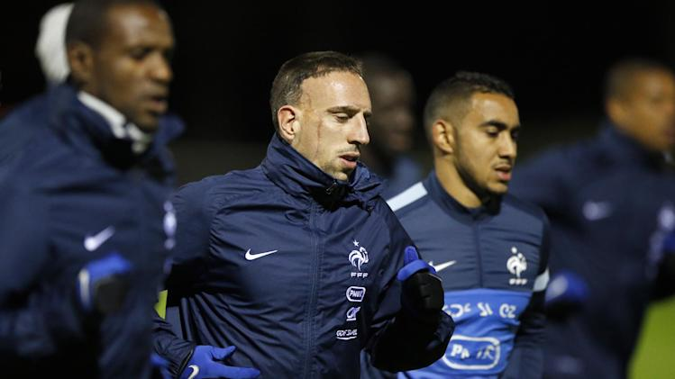 France's soccer forward Franck Ribery, center, runs with Eric Abidal, left, and Dimitri Payet, right, during a training session at Clairefontaine training center, south of Paris, Monday, Nov. 11, 2013, ahead of their 2014 World Cup qualifying soccer match against Ukraine