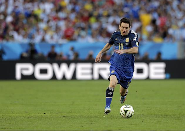 DISTRIBUTED FOR TCCC - Argentina's Lionel Messi (10) dribbles the ball up field against Germany in the World Cup final soccer match at the Maracana Stadium in Rio de Janeiro, Brazil, Sunday, July 13,