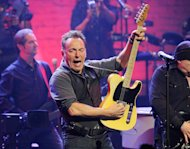 Bruce Springsteen and the E Street Band perform at the Apollo Theater on Friday, March 9, 2012 in New York. The concert was hosted by SiriusXM in celebration of 10 years of satellite radio. (AP Photo/Evan Agostini)