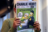 A man reads the back cover of French satirical weekly Charlie Hebdo in Paris. As protests again erupted across the Muslim world on Wednesday over an anti-Islam film, the French magazine poured fuel on the fire by publishing obscene cartoons depicting the Prophet Mohammed