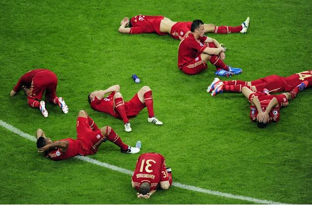 TOPSHOTS Players Of Bayern Munich Lay On The Pitch AFP/Getty Images
