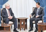 A handout picture released by the official Syrian Arab News Agency (SANA) on September 18, 2013 shows Russian Deputy Foreign Minister Sergei Ryabkov (left) meeting with Syrian President Bashar al-Assad in Damascus