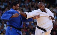 France's Teddy Riner (white) competes with Cuba's Oscar Brayson (blue) during their men's +100kg judo contest quarter final match of the London 2012 Olympic Games at the ExCel arena in London. Judoka Wojdan Shaherkani became the first woman from Saudi Arabia to compete at the Olympics while Teddy Riner and home favourite Karina Bryant lit up the ExCel Arena