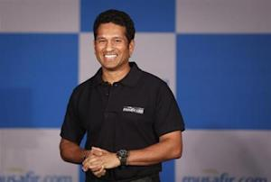 Indian cricket player Sachin Tendulkar speaks during a news conference to launch a travel portal in Mumbai October 23, 2013. REUTERS/Danish Siddiqui/Files