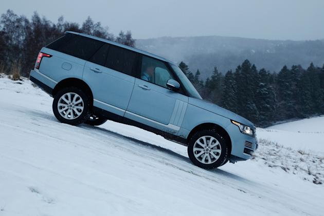 Range Rover: 	It's the new Range Rover's job to look good everywhere, from deserts to driveways, and though the press drives off-road were the tamest I've ever seen, and the car slid about on its fat