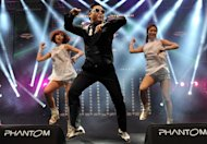 "South Korean singer Psy (L) performs his hit single ""Gangnam Style"" during a concert in Istanbul on February 22, 2013. YouTube will livestream a debut concert performance of Psy's hugely anticipated follow-up to his global hit ""Gangnam Style,"" the South Korean sensation announced in a teasing video message"