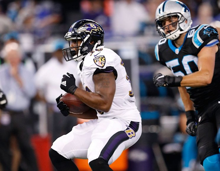 Kenneth Dixon #30 of the Baltimore Ravens runs with the ball during a preseason NFL game against the Carolina Panthers. (Photo by Joe Robbins/Getty Images)