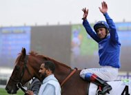 File picture of Frankie Dettori at the Dubai World Cup in March. The jockey -- probably racing's most well known personality -- is set to learn his fate for failing a drugs test when French racing's ruling body France Galop issue their verdict at a disciplinary hearing on Tuesday
