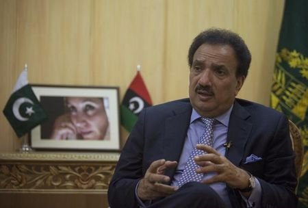 Pakistan's Interior Minister Rehman Malik speaks during an interview with Reuters.