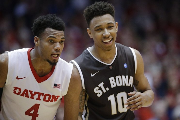 Dayton's Charles Cooke and St. Bonaventure's Jaylen Adams are both league player of the year candidates. (AP)
