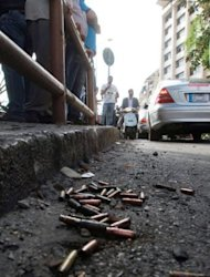 Bullet cases lie on the street outside the offices of pro-Syrian Arab Current Party in Beirut on Monday. The latest fighting erupted hours after reports emerged that Lebanese army troops had shot dead Sheikh Ahmad Abdul Wahad, a prominent anti-Syria Sunni cleric