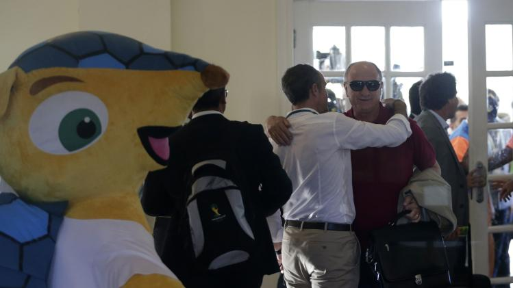 Brazil's head coach Scolari is greeted as he arrives at Sauipe Class Hotel ahead of the 2014 World Cup draw at the Costa do Sauipe resort in Sao Joao da Mata, Bahia state