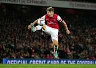 Andrey Arshavin controls the ball before scoring the third goal for Arsenal during a League Cup match against Coventry at the Emirates last week. Russia manager Fabio Capello has left Arshavin out of his 24-man squad to play 2014 World Cup Group F qualifying matches with Portugal and Azerbaijan in Moscow later this month