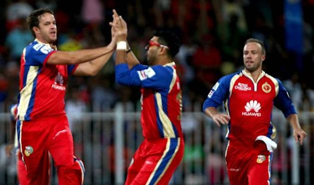 RCB players Albie Morkel, Yuvraj Singh and AB de Villiers celebrate fall of a wicket during the second match of IPL 2014 between Delhi Daredevils and Royal Challengers Bangalore, played at Sharjah Cri