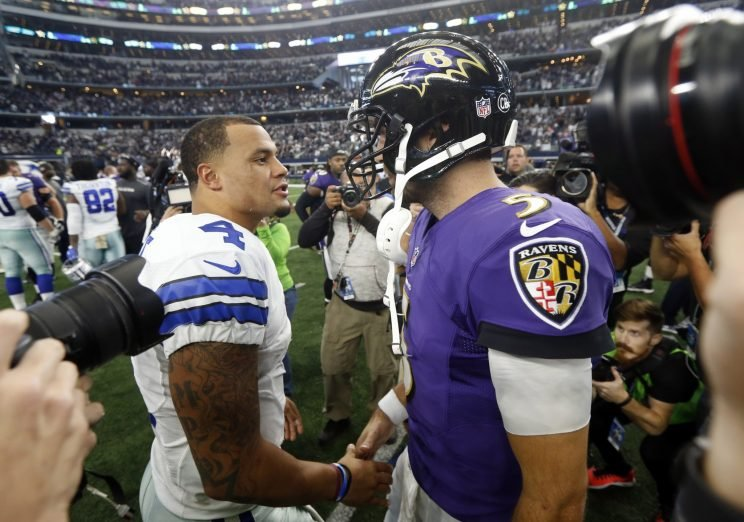 Joe Flacco greets Dak Prescott after Dallas beat Baltimore on Sunday (AP)