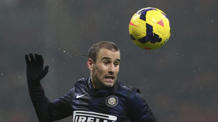 Inter Milan forward Rodrigo Palacio, of Argentina, heads the ball during a Serie A soccer match between Inter Milan and Chievo Verona, at the San Siro stadium in Milan, Italy, Monday, Jan. 13, 2014