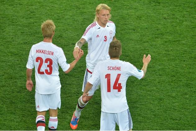 (From L) Danish Forward Tobias Mikkelsen, Danish Defender Simon Kjær And Danish Midfielder Lasse Schone Celebrate At AFP/Getty Images