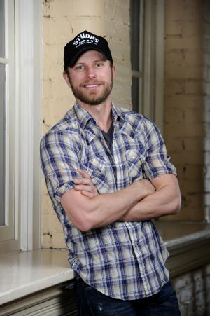 "In this Feb. 2, 2012 photo, country Artist Dierks Bentley poses for a photo at the Ryman Auditorium in Nashville, Tenn.  Bentley's latest release, ""Home,"" was released this week. (AP Photo/Donn Jones)"