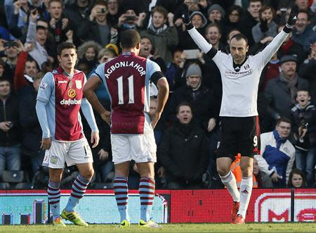 Fulham's Berbatov celebrates after scoring during their English Premier League soccer match against Aston Villa in London