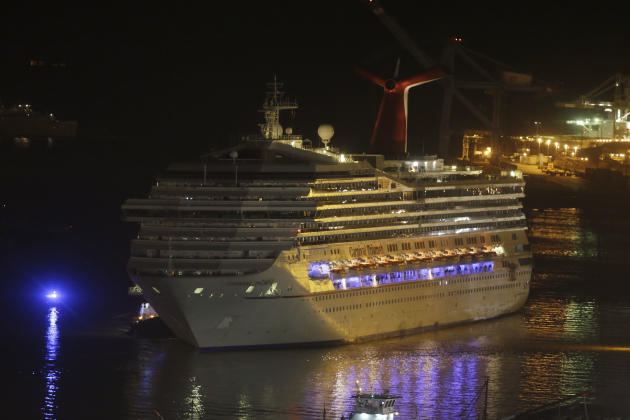 The cruise ship Carnival Triumph is towed up the Mobile River in Mobile, Ala., Thursday, Feb. 14, 2013. The ship with more than 4,200 passengers and crew members has been idled for nearly a week in th